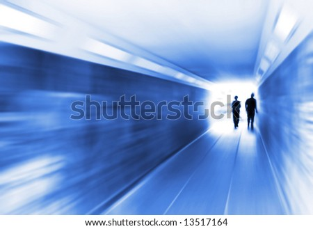 Urban Blues, fast life in the City with two Business People in underpass Blur emerging from the light - stock photo