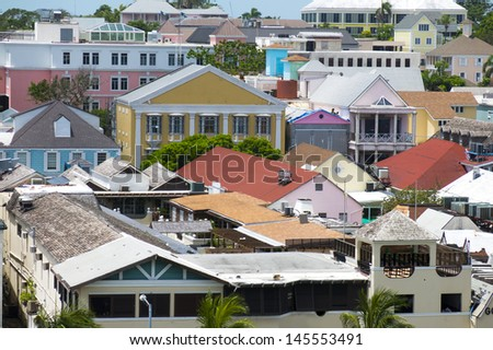 Urban building congestion showing many roofs both commercial and residential - stock photo