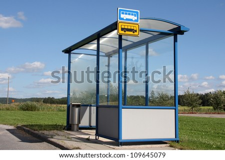 Urban bus stop shelter by street at summer in Salo, Finland. - stock photo