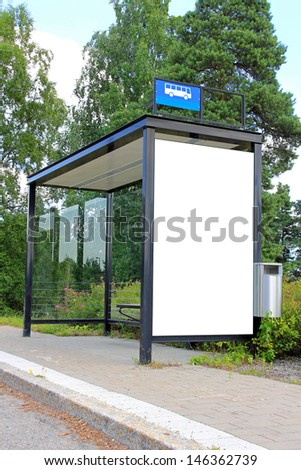 Urban bus stop shelter with single blank billboard for your advertisement. - stock photo