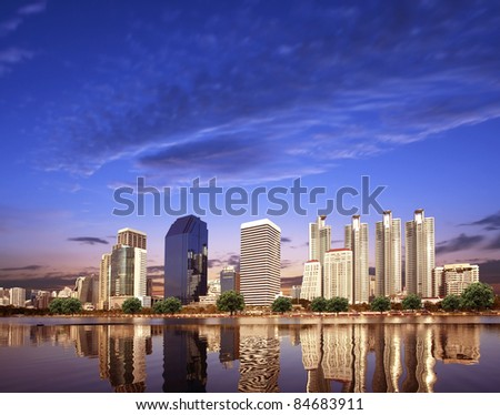 Urban City Skyline in the evening with Beautiful Sky and Reflection in the Lake