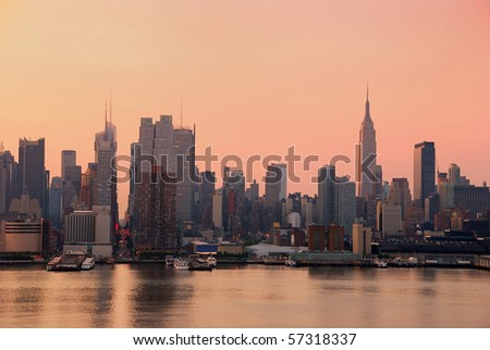 Urban City skyline. New York City Manhattan skyline with Empire State building and skyscrapers over Hudson River. - stock photo