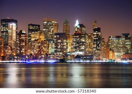 Urban City skyline night scene, New York City Manhattan skyline at night - stock photo