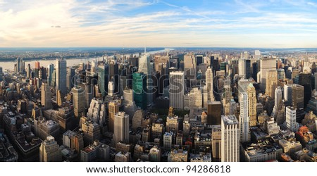 Urban city sunset panorama aerial view. New York City Manhattan aerial panorama view with New Jersey from west Hudson River and skyscrapers at sunset. - stock photo
