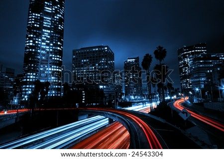 Urban City with Freeway Overpass Traffic, and Night Skyline, - stock photo