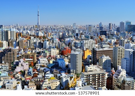 Urban cityscape of Tokyo with the Tokyo Skytree in the distance. - stock photo