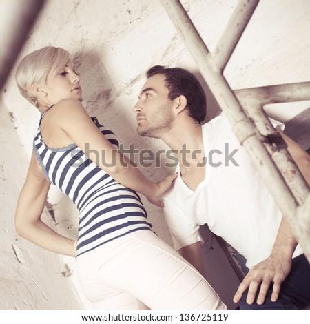 urban couple, man and woman posing - colorized photo - stock photo