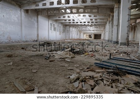 Urban decay series. Abandoned plant building interior - stock photo