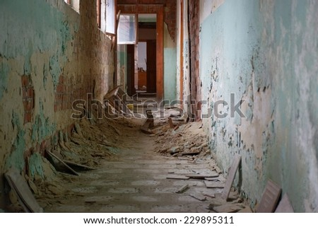 Urban decay series. Abandoned plant building interior - corridor - stock photo