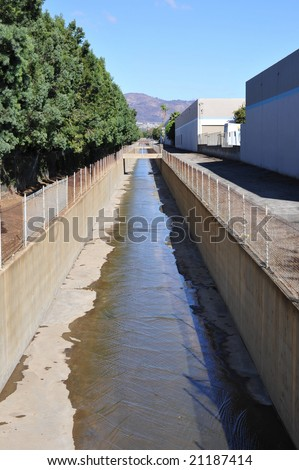 urban drainage system storm drain flood control channel - stock photo