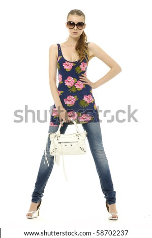 Urban fashion girl with modern bag. Isolated - stock photo