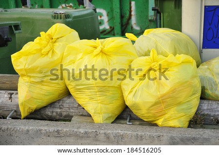urban garbage, yellow recycling plastics - stock photo