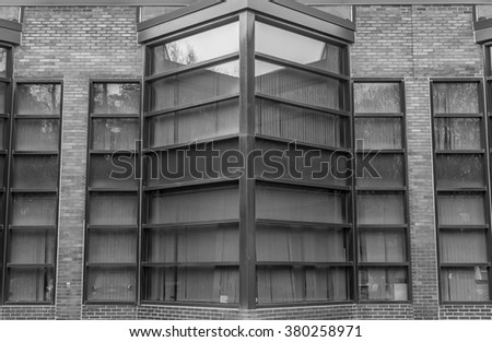 Urban Geometry. Modern architecture black and white, concrete and glass.  Abstract architectural design. Inspirational, artistic image BW. Artistic image and point of view. Reflections in window. - stock photo