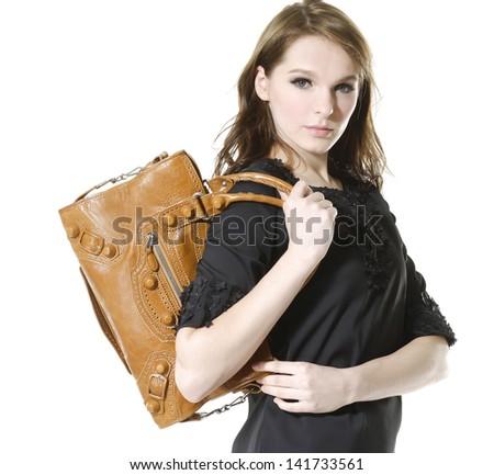 Urban girl with modern bag. posing in studio - stock photo
