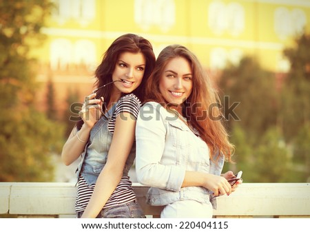 Urban Girls .Two cheerful young women walking  - stock photo