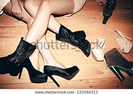 urban girls with their shoes indoor shot - stock photo