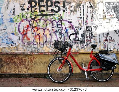 Urban graffiti and bike in a Amsterdam alley - stock photo