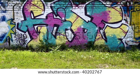 Urban graffiti art on the side of a building - stock photo