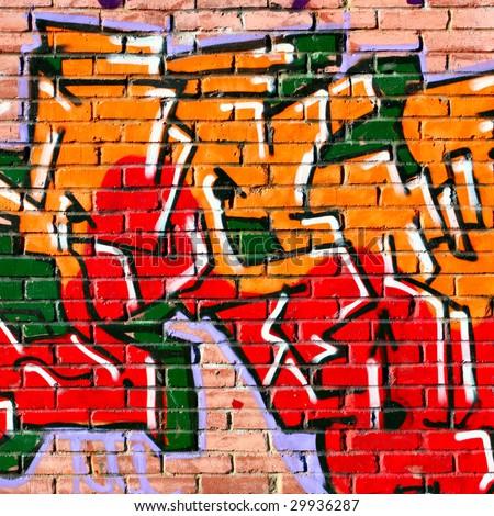Urban graffiti over bricks wall close-up - stock photo