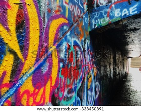 Urban graffiti wall on campus free expression underpass - stock photo