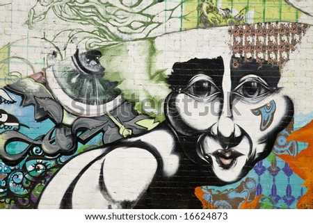 Urban grafitti art on the side of a building in downtown Phoenix Arizona. - stock photo