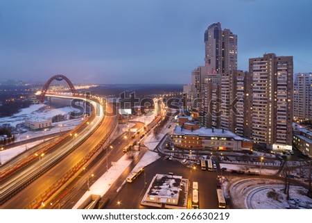 Urban highway, bridge over river and residential district of Moscow in winter night. Long exposure - stock photo