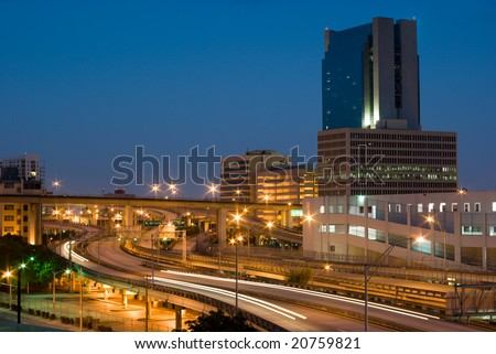 Urban Highway Interchange and Buildings Shortly Before Dawn - stock photo