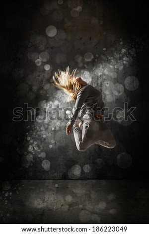 Urban hip hop dancer, grunge concrete wall background - stock photo