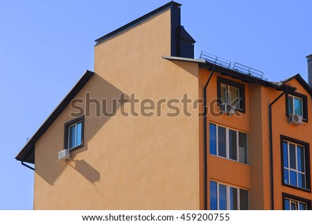 Urban house or building, facade pattern. blue sky
