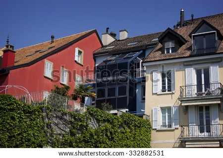 Urban houses in Switzerland - roof, window, balcony.