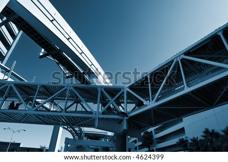 Urban infrastructure. Knot made of bridges between buildings and a monorail. - stock photo
