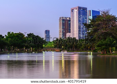 Urban lake and bridge with cityscape background in summer.