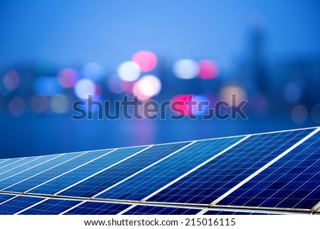 Urban landscape as the background of the solar panel - stock photo
