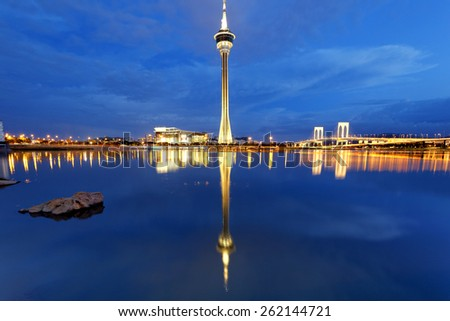 Urban landscape of Macau with famous traveling tower under sky near river in Macao, Asia. - stock photo
