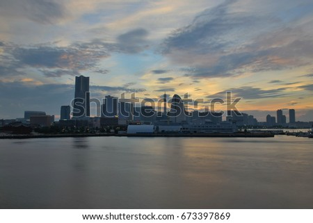 Urban Landscape of Yokohama, Japan with moving colorful clouds in horizontal frame