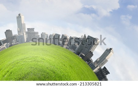 Urban landscape on green planet surface. Ecology idea - stock photo