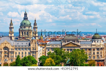 Urban landscape panorama with old buildings and domes of opera in budapest hungary - stock photo