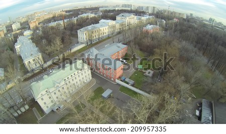 Urban landscape with widows houses and Chief Military Clinical Hospital named after Nikolai Burdenko in autumn, aerial view - stock photo