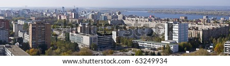 Urban landscape. XXL Size. Typical residential area on the riverbank. The view from the heights in the background the river Volga and Zhiguli Mountains. Russia. - stock photo