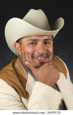 Urban Latino male with cowboy hat