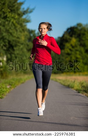 Urban leisure - woman running outdoor - stock photo
