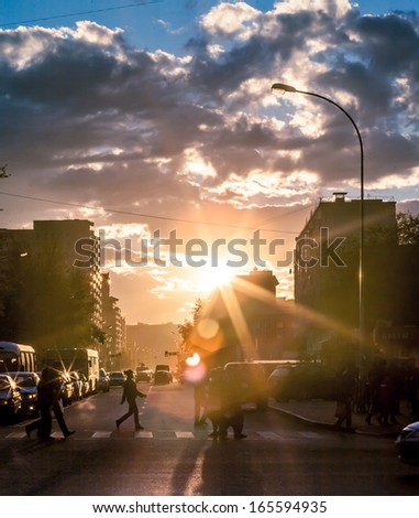 Urban life in vain hour before sunset, the city of Astana Kazakhstan. To me these shots especially the road. Picture which can be called art. - stock photo