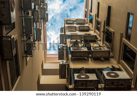 Urban Mess - A lot of Air conditioner (aircon) in a housing building - stock photo