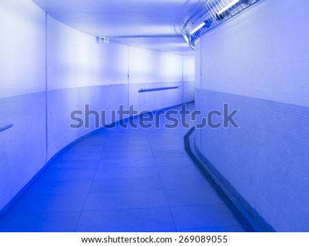 urban metro passage in neon blue light - stock photo