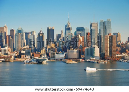 Urban metropolis city skyline, Manhattan with Empire State Building, New York City over Hudson River with boat and pier. - stock photo