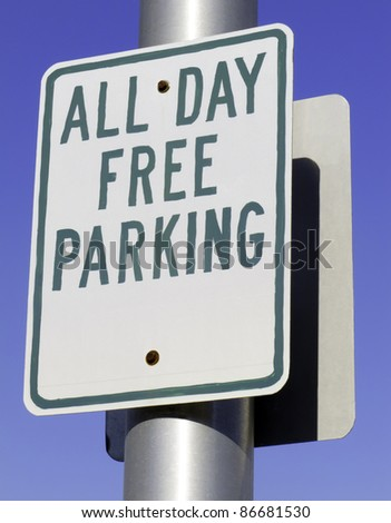 Urban motorist's dream sign: All Day Free Parking - stock photo
