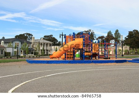 Urban neighborhood elementary school playground - stock photo