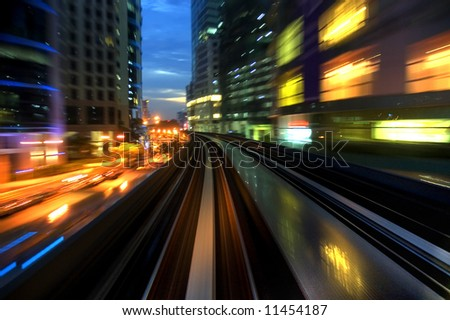 Urban night traffics view. Focus on the road. - stock photo
