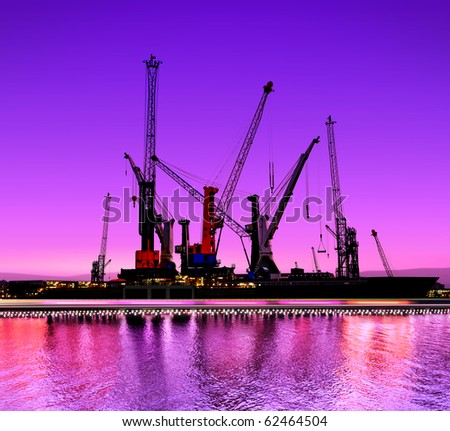 urban night view of the shipyards with cranes - stock photo