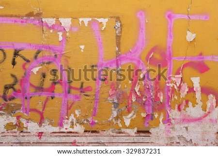 Urban Old Concrete Graffiti Wall With Peeled Paint And Ripped Ads Background Texture - stock photo